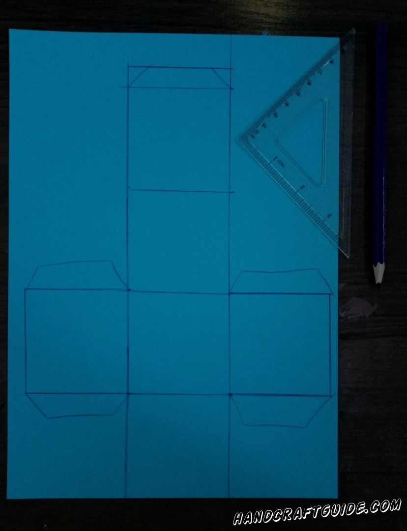 First, draw, under the ruler, the squares, as in the picture.