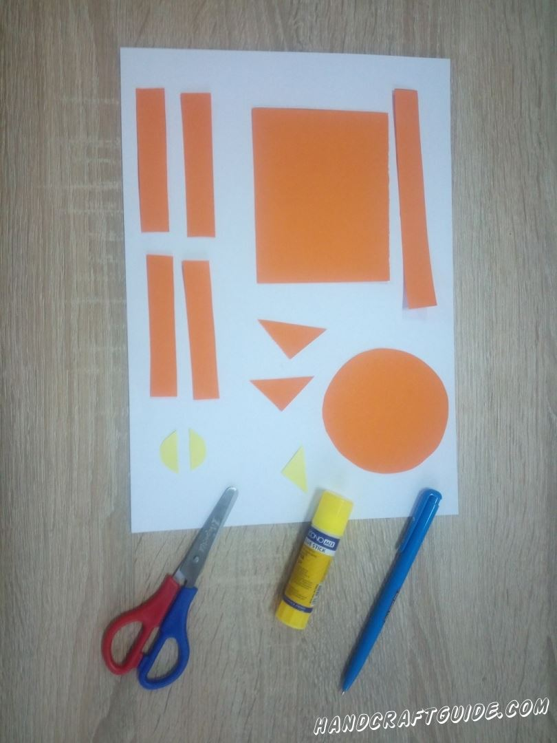 Cut the neeeded details out of colored paper as shown in the photo.