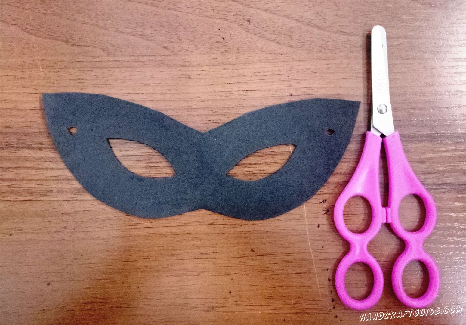 First we need to draw a mask on the sheet with felt. After that, according to your sketch, we cut out our mask. For cutting out the holes for the eyes, you can use both a  knife and  scissors (cut out on the bend).