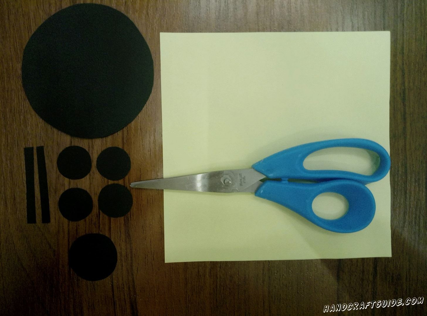 Cut  all the details out of the black paper as shown in the photo.