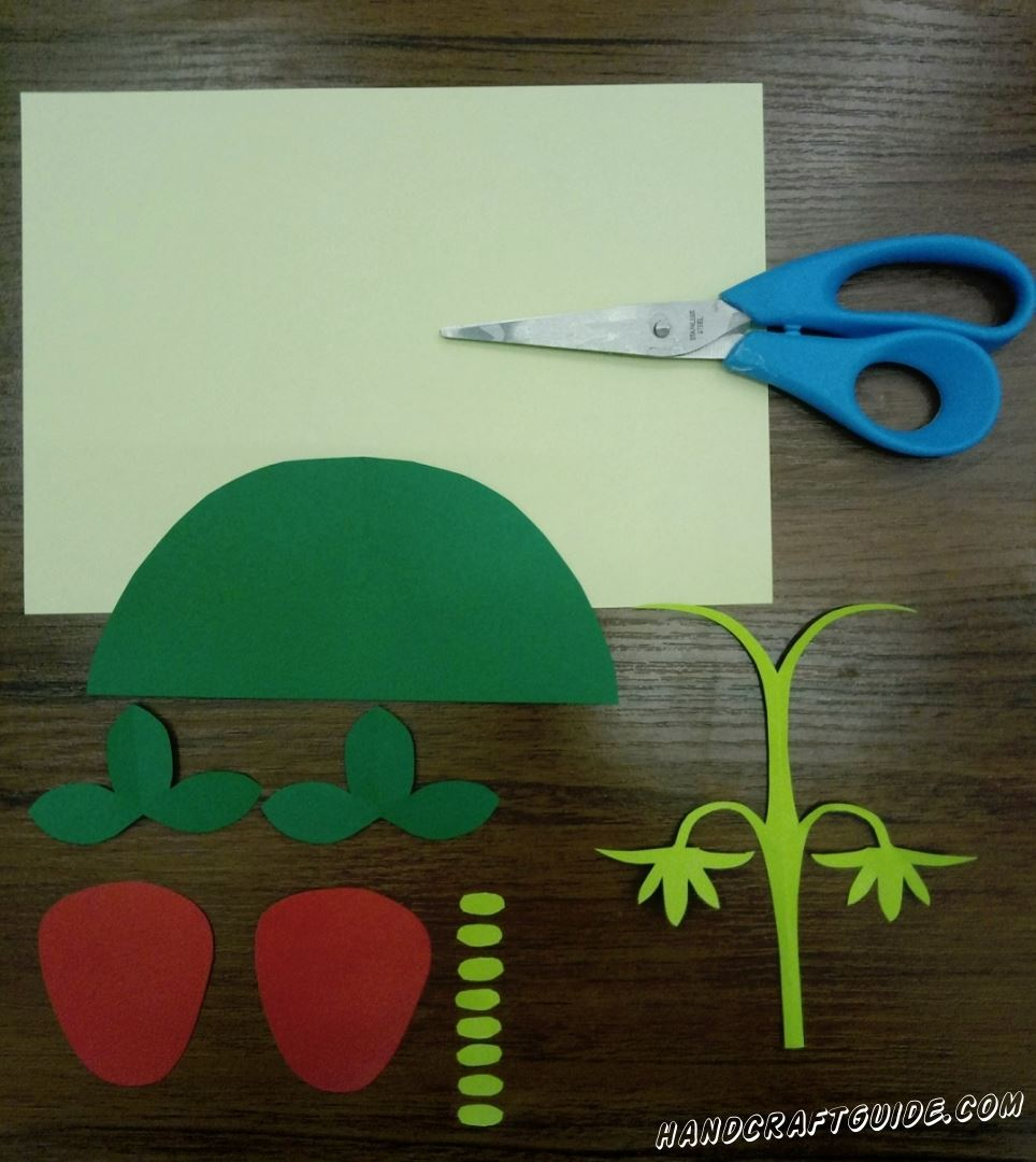 First, cut out all neede details. Cut 1 semicircle and 3 trefoil out of green paper. Now take red paper and cut out 2 strawberries. Let's keep cutting out. Now we need 8 small light green ovals and 1 stalk with 4 twigs, try to make them as in the photo. Cut rectangle that has the same width as green semicircle out of pale yellow paper.  Done, and now let's glue everything together...