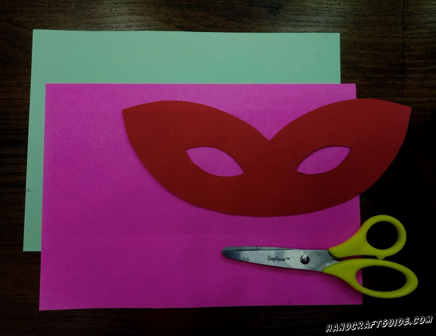 First, take red paper and cut out the basis of the mask, do not forget to cut holes for the eyes, so you can see when you wear it.
