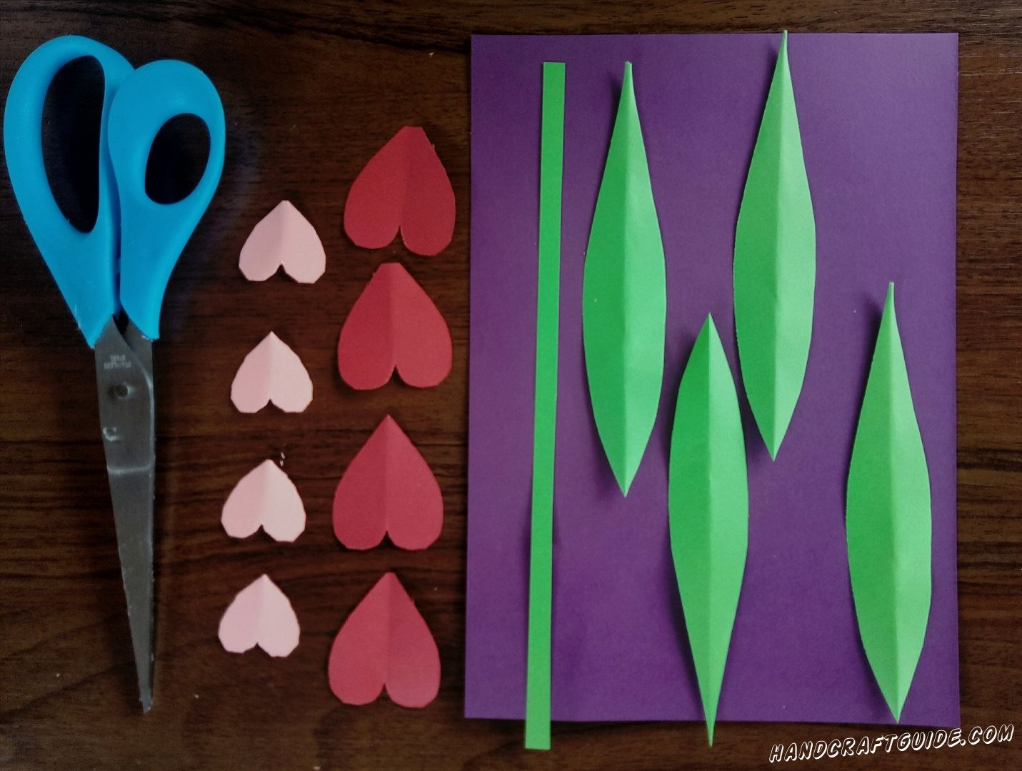 Cut out hearts, leaves and stem, as in the photo.