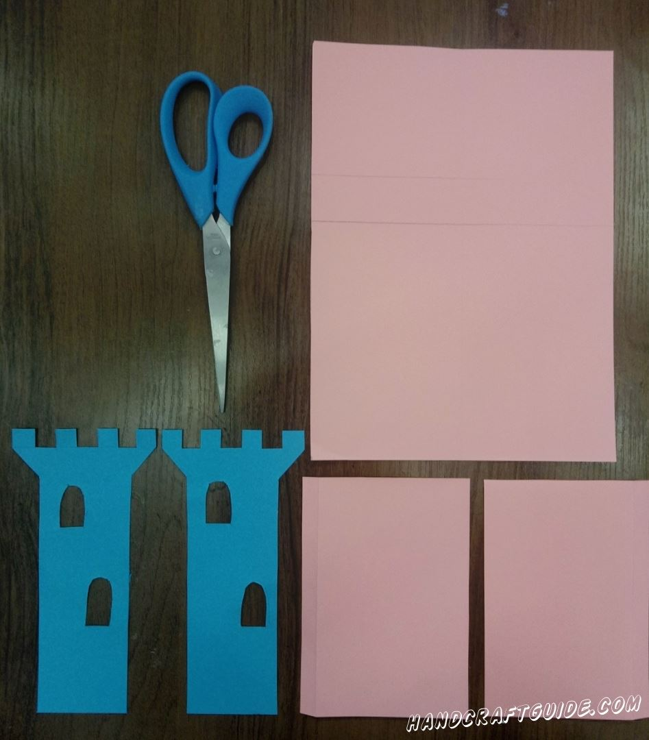 For the beginning we will cut out, from a blue paper, 2 towers with windows.