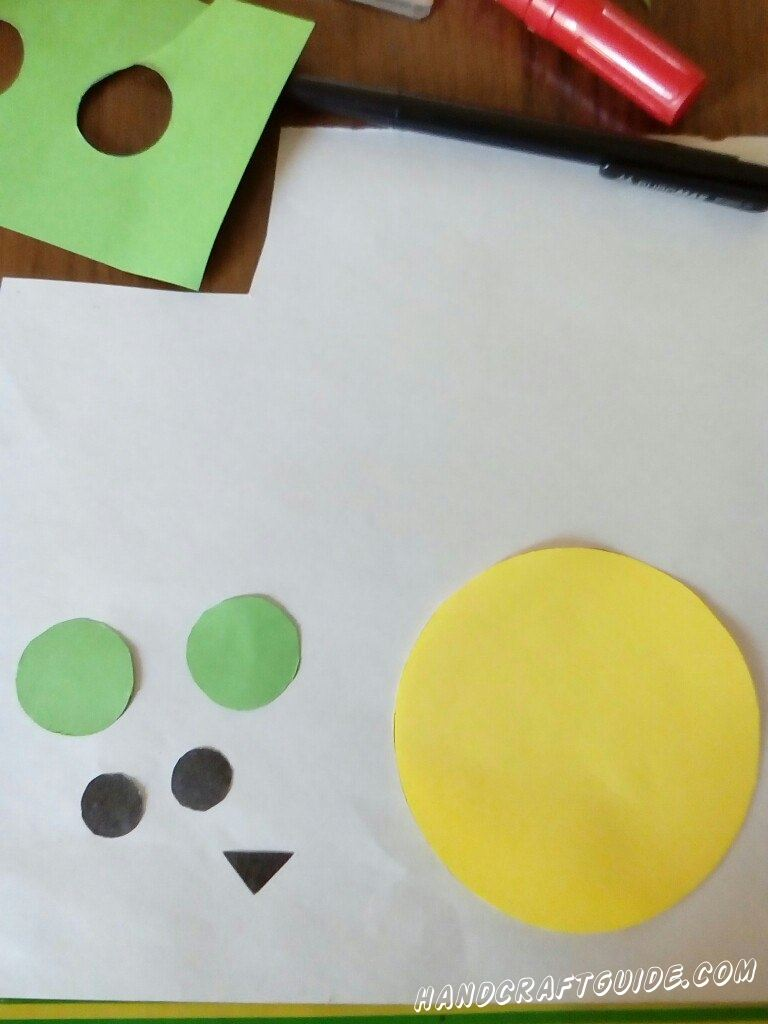 From the colored paper cut out the head and face for our owls