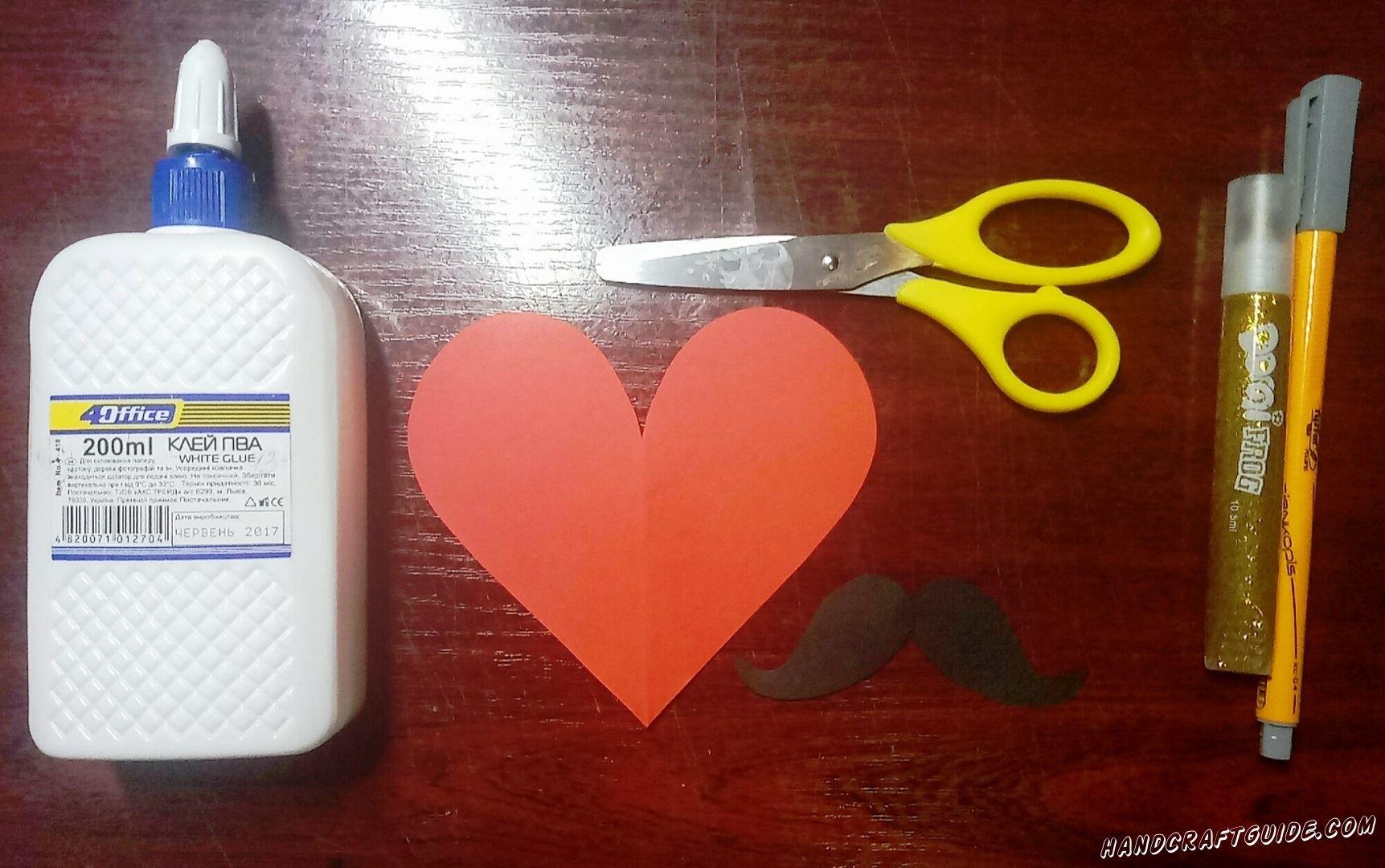 Вырезам сердечко из бумаги красного цвета. Также нам нужны бумажные усы, чёрного цвета.