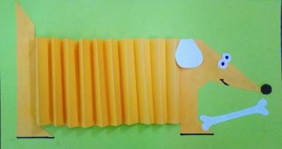 Замечательную собачку, в форме гармошки, из цветной бумаги мы сделаем прямо сейчас.